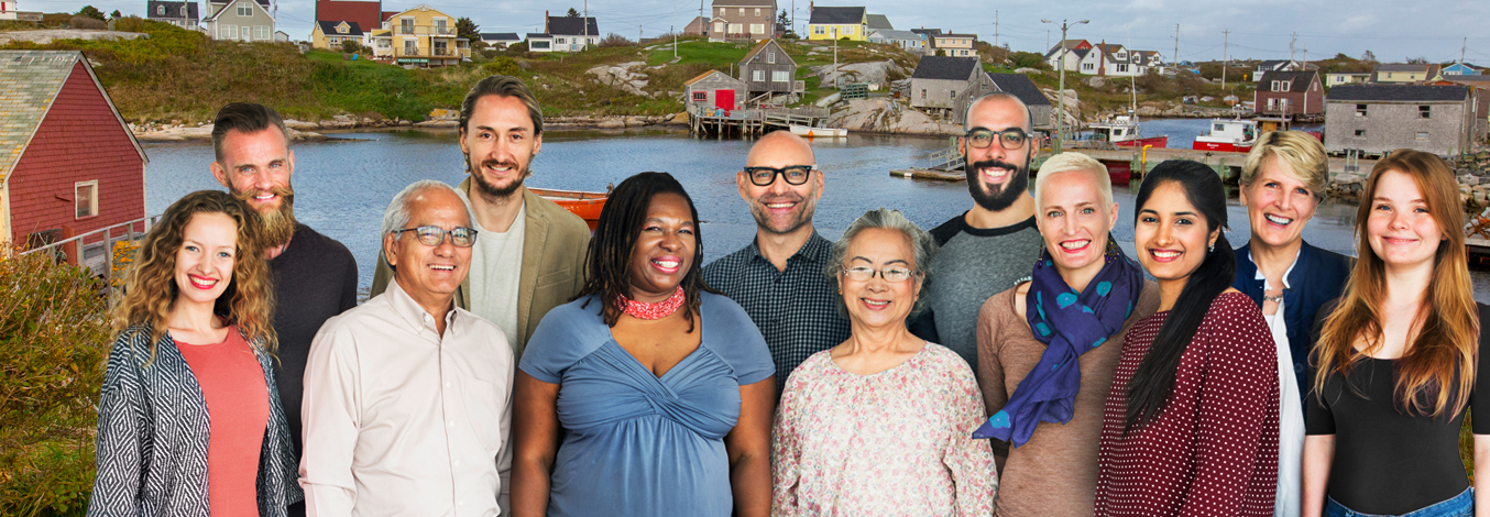 People from multiple different ethnic backgrounds smiling in front of Maritime scene
