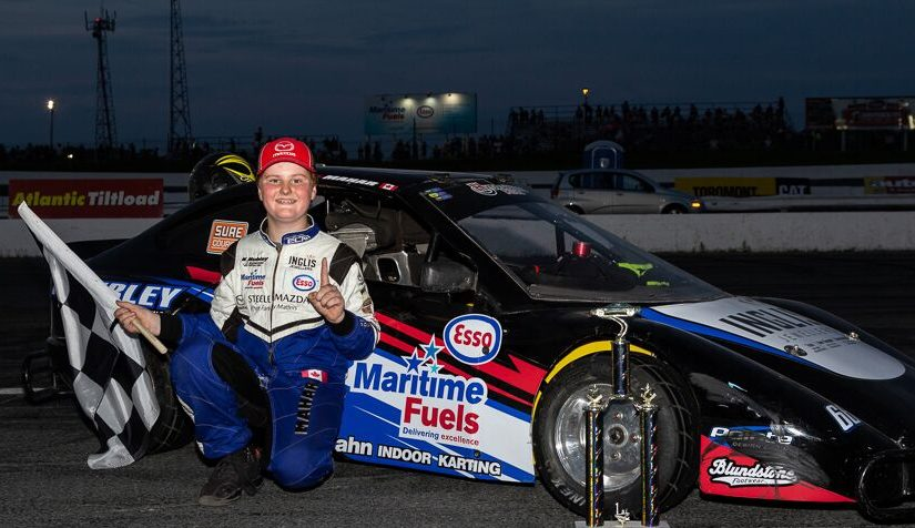DM Motorsports: Owen Mahar 66 in front of his race car